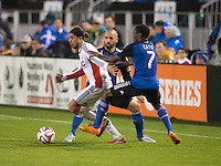 Santa Clara, California -Saturday, March 29, 2014: Lee Nguyen of New England Revolution fights away from Cordell Cato and Brandon Barklage of Earthquakes during a match at Buck Shaw Stadium. Final Score: SJ Earthquakes 1, NE Revolution 2