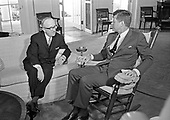 "United States President John F. Kennedy, right, meets with Walter Hallstein, President of the European Common Market, in the Oval Office of the White House in Washington, DC on March 4, 1963.  The two leaders conferred for over an hour during the morning.  Hallstein is scheduled to meet other US officials concerning US participation in the controversial Common Market.<br /> Credit: Benjamin E. ""Gene"" Forte / CNP"