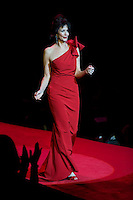 2/13/09 - Photo by John Cheng.  Lynda Carter walks down the runway at the Red Dress Collection Fashion Show in Bryant Park, New York.  February is National Heart Month, and the fashion show is part of the month-long activities to raise women?s heart disease awareness.