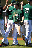 Dartmouth Big Green third baseman Justin Fowler (25) high fives teammates after a game against the Eastern Michigan Eagles on February 25, 2017 at North Charlotte Regional Park in Port Charlotte, Florida.  Dartmouth defeated Eastern Michigan 8-4.  (Mike Janes/Four Seam Images)