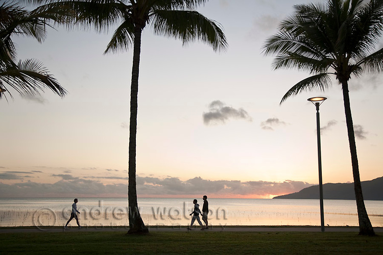 Early morning walkers on the Esplanade.  Cairns, Queensland, Australia