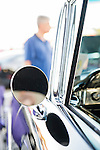 Bellmore, New York, USA. 7th August 2015. A visitor looks at an historical 1958 Black Biscayne Sports Coupe, owned by JOHN BROKOS, of Merrick, at the Friday Night Car Show held at the Bellmore Long Island Railroad Station Parking Lot. Hundreds of classic, antique, and custom cars were on view at the free weekly show, sponsored by the Chamber of Commerce of the Bellmores.