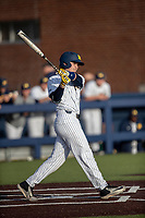 Michigan Wolverines catcher Casey Buckley (24) follows through on his swing during the NCAA baseball game against the Eastern Michigan Eagles on May 8, 2019 at Ray Fisher Stadium in Ann Arbor, Michigan. Michigan defeated Eastern Michigan 10-1. (Andrew Woolley/Four Seam Images)
