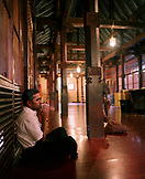 SRI LANKA, Asia, Kandy, side view of men praying in the temple of the tooth