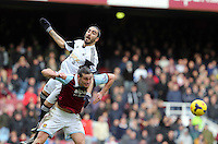 Pictured: The header challenge between Andy Carroll of West Ham (FRONT) and Chico Flores (TOP) of Swansea which resulted in the former seeing a red card by match referee Howard Webb. 01 February 2014<br />