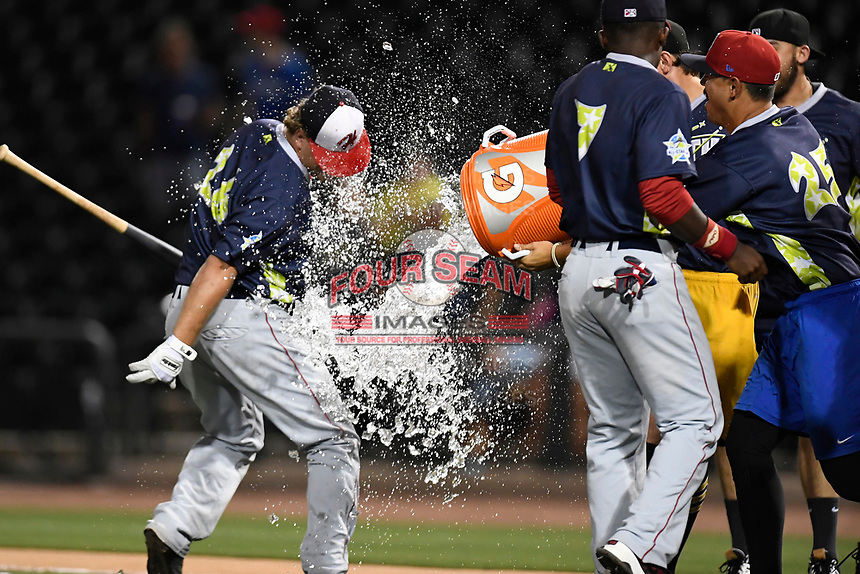 Sheldon Neuse of the Hagerstown Suns is hit with a water bucket by fellow North teammates after winnng the Home Run Derby as part of the South Atlantic League All-Star Game festivities on Monday, June 19, 2017, at Spirit Communications Park in Columbia, South Carolina. (Tom Priddy/Four Seam Images)