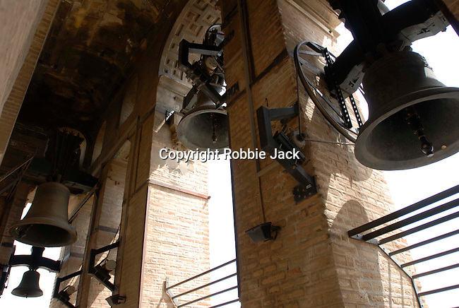 Bells in the tower at the Cathedral of Saint Mary of the See and La Giralda in Seville, Spain. The largest gothic cathedral in the world, it occupies the site of Hagia Sophia, a mosque built by the Almohads in the late 12th century. La Giralda, its bell tower, is a legacy from the Moorish structure.