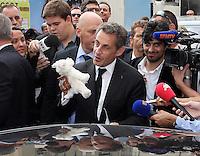 Nicolas Sarkozy receives a teddy bear in Nice - France