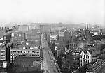 Pittsburgh PA: View of City from the top of the Empire Building - 1904. View of the city looking up Liberty Avenue towards the Pennslyvania Railroad Station. View of three sets of trolley tracks on Liberty Avenue. Company signs on city buildings included: C.A. Verner Shoes, Home Trust Company of Pittsburgh, JC Lindsay Hardware Company, JG Lauer Toys on Liberty Avenue, John Wallace Produce, Lyle Brothers Hardware on Liberty Avenue, Monongahela National Bank, New York Dentist on Liberty Avenue, Pennsylvania Railroad Station, and Renwick Brothers Wholesale Millinery