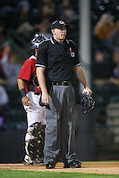 Home plate umpire Jacob Metz during the South Atlantic League game between the Kannapolis Intimidators and the Hickory Crawdads at L.P. Frans Stadium on April 23, 2015 in Hickory, North Carolina.  The Crawdads defeated the Intimidators 3-2 in 10 innings.  (Brian Westerholt/Four Seam Images)
