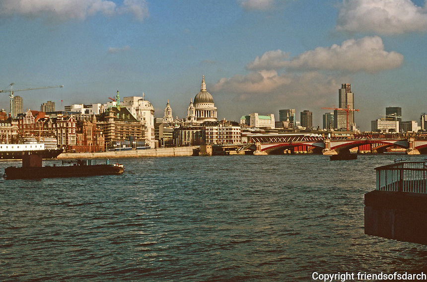 London: Thameside Walk #9.   St. Paul's, center. Blackfriars Bridge 1869.  White building to left of St. Paul's, Unilever House, and west of it, City of London Boys School; Nat. Western Tower, right. Photo '90.