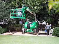Construction crane in the Rose Garden of the White House looking from the Oval Office in Washington, DC as it is undergoing renovations while United States President Donald J. Trump is vacationing in Bedminster, New Jersey on Friday, August 11, 2017.<br /> CAP/MPI/CNP/RS<br /> &copy;RS/CNP/MPI/Capital Pictures