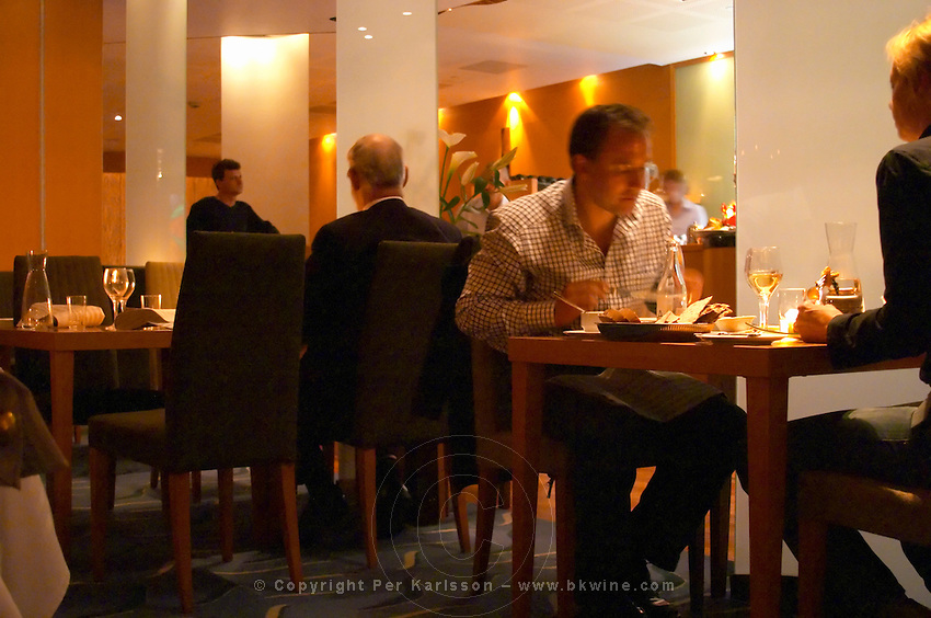 The interior of the restaurant Stockholms Fisk (Stockholm's Fish) with guests dining. Stockholm, Sweden, Sverige, Europe