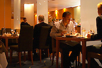 The interior of the restaurant Stockholms Fisk (Stockholm's Fish) with guests dining. Stockholm, Sweden, Sverige, Europe