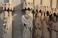 Statues of the apostles (St John without a beard), restored 1821-47 under Auguste Cheussey, by the sculptor Theophile Caudron, on the embrasures of the central portal, known as the Beau-Dieu portal, dedicated to the Last Judgment, on the Western facade of the Basilique Cathedrale Notre-Dame d'Amiens or Cathedral Basilica of Our Lady of Amiens, built 1220-70 in Gothic style, Amiens, Picardy, France. The ommission of several attributes when replacing the statues means the apostles are now difficult to recognise. Amiens Cathedral was listed as a UNESCO World Heritage Site in 1981. Picture by Manuel Cohen
