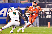 Charlotte, NC - DEC 2, 2017: Clemson Tigers quarterback Kelly Bryant (2) runs the football during ACC Championship game between Miami and Clemson at Bank of America Stadium Charlotte, North Carolina. (Photo by Phil Peters/Media Images International)