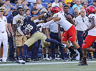 Annapolis, MD - September 23, 2017: Navy Midshipmen running back Keoni-Kordell Makekau (36) gets pushed out of bounds during the game between Cincinnati and Navy at  Navy-Marine Corps Memorial Stadium in Annapolis, MD.   (Photo by Elliott Brown/Media Images International)