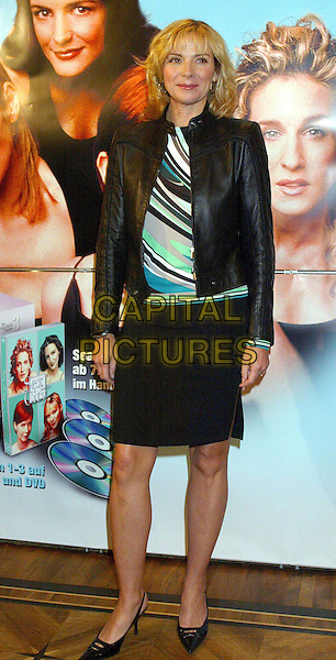 "KIM CATTRALL.Promoting ""Sex & The City"" DVD/Video Release In Hamburg.Ref: Tjaberg .diagonal stripes, leather jacket, black skirt, full length, full-length.www.capitalpictures.com.sales@capitalpictures.com.©Capital Pictures *** Local Caption *** 00107032"