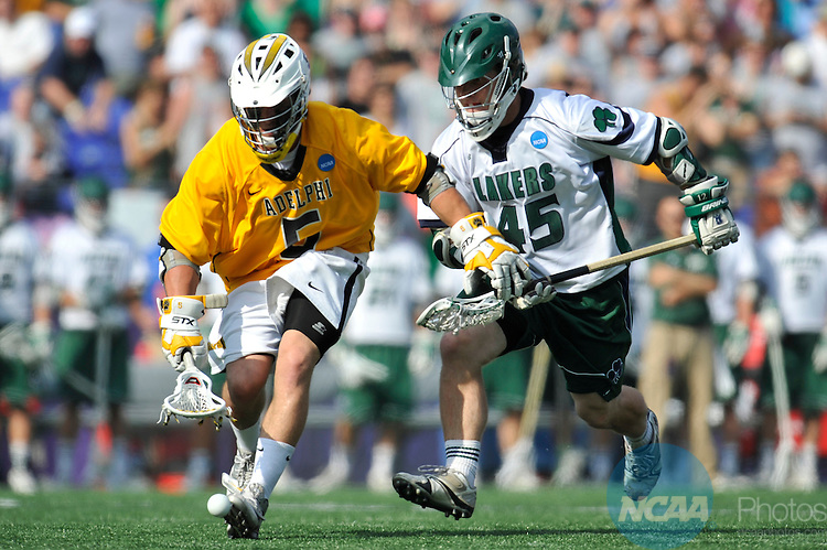 29 MAY 2011:  Jesse Colamussi (5) of Adelphi University chases a ball after a faceoff against Mitch McAvoy (45) of Mercyhurst College during the Division II Men's Lacrosse Championship held at M+T Bank Stadium in Baltimore, MD.  Mercyhurst defeated Adelphi 9-8 for the national title. Larry French/NCAA Photos