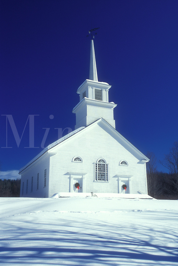 white church, Vermont, VT, Snow-covered Union Meeting House (1825) decorated with wreaths on the doors in the winter in Burke Hollow.
