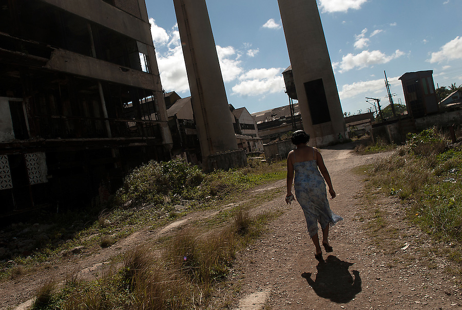 A woman walking by the abandoned factory that once belonged to the Hershey Chocolate Company.