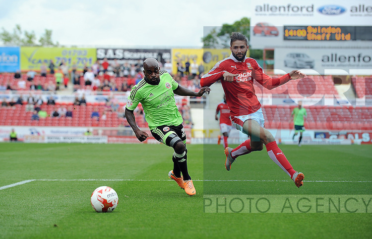 Jamal Campbell-Ryce of Sheffield United is challenged by Jordan Turnbull of Swindon Town<br /> - English League One - Swindon Town vs Sheffield Utd - County Ground Stadium - Swindon - England - 29th August 2015 <br /> --------------------