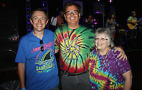 NWA Democrat-Gazette/CARIN SCHOPPMEYER Nick Zazal (from left), Marty Seifert and Beth Hopkins attend the Walton Arts Center's volunteer appreciation night at George's.