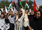 Palestinian women chant slogans and wave their national flag during a demonstration in support of Palestinian leader Mahmud Abbas' bid for statehood recognition at the United Nations on September 22, 2011 in Gaza City.  Photo by Mahmud Nassar