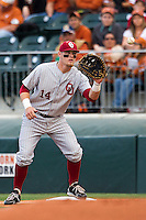 Oklahoma Sooners first basman Matt Oberste #14 makes a putout against the Texas Longhorns in the NCAA baseball game on April 5, 2013 at UFCU DischFalk Field in Austin Texas. Oklahoma defeated Texas 2-1. (Andrew Woolley/Four Seam Images).