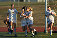 NWA Democrat-Gazette/BEN GOFF @NWABENGOFF<br /> Ginger Olson (from left), Tyler Ann Reash, Sydney Suggs and Meagan Gotwalt of Bentonville celebrate a goal by Olson against Fayetteville Tuesday, March 13, 2018, during the match at Bentonville's Tiger Athletic Complex.