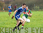 Aidan Walsh in control closely pursued by Alan Smith in Valentia during the South Kerry Championship Semi Final on Sunday.