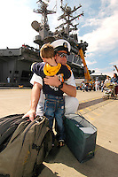 060808-N-7981E-213 Everett Naval Station (August 8, 2006)- Senior Chief Navy Counselor Stephen Rogers is embraced by his son after returning from a deployment aboard the Nimitz-class aircraft carrier USS Abraham Lincoln (CVN-72). Lincoln returned to its home port of Everett WA today after a scheduled five and a half month deployment to the Western Pacific. U.S. Navy photo by Mass Communications Specialist Seaman James R. Evans (RELEASED)