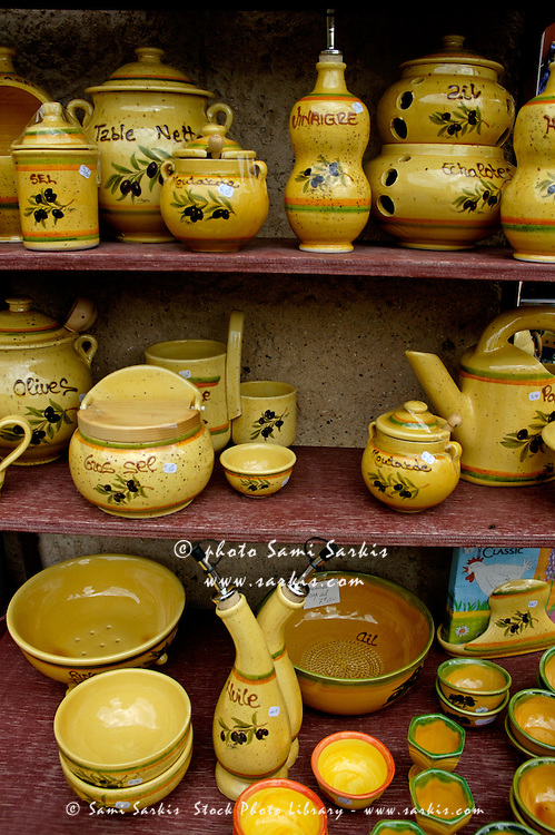 Pottery on display inside a shop, Moustiers-Sainte-Marie, Provence, France.