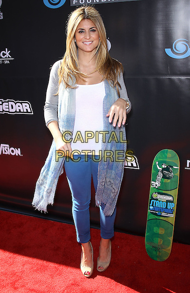 Alison Victoria.Tony Hawk's 3rd Annual Stand Up For Skateparks fundraiser at Red Rock Station Hotel and Casino, Las Vegas, Nevada, USA.  .November 5th, 2011.full length jeans denim white grey gray blue cardigan.CAP/ADM/MJT.© MJT/AdMedia/Capital Pictures.