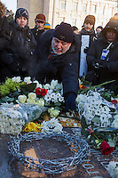 Moscow, Russia, 15/12/2012..A man lays flowers on a memorial to KGB victims in Lubyanka Square at an unauthorised opposition rally to mark a year of protests against Vladimir Putin.