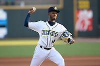 Starting pitcher Daison Acosta (18) of the Columbia Fireflies delivers a pitch in a game against the Rome Braves on Saturday, August 17, 2019, at Segra Park in Columbia, South Carolina. Rome won, 4-0. (Tom Priddy/Four Seam Images)