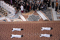 Priests prostate themselves during a mass celebrated by Pope Francis during a priests ordination ceremony in St Peter's Basilica at the Vatican.  on April 21, 2013