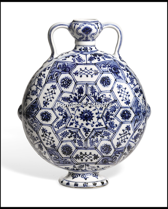 BNPS.co.uk (01202 558833)<br /> Pic: Sothebys/BNPS<br /> <br /> Rare Blue and White Moonflask sold for £10.4 million.<br /> <br /> A collection of Chinese antiques that a farmer paid as little as £100 per item for has sold for a whopping £45.9 million.<br /> <br /> The late Roger Pilkington accumulated about 100 pieces of exquisite Chinese ceramics in the late 1950s and early '60s <br /> <br /> He died in 1969 aged just 40. His 'time capsule' collection has remained in his family ever since and they have now sold it at auction.<br /> <br /> Leading the sale was a 9ins tall 15th century blue and white Moon Flask which sold for a £10.1m.