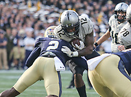 Annapolis, MD - October 21, 2017: UCF Knights running back Taj McGowan (12) gets tackled by Navy Midshipmen safety Jarid Ryan (2) during the game between UCF and Navy at  Navy-Marine Corps Memorial Stadium in Annapolis, MD.   (Photo by Elliott Brown/Media Images International)