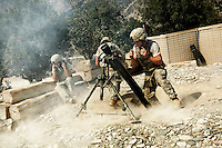The 120mm mortar company at the American Korengal Outpost (kop) base return fire to insurgent positions after coming under attack..Battle Company, 2nd Battalion Airborne of the 503rd US Infantry are undergoing a 15 month deployment in the Korengal Valley, epicentre of the war and scene of fierce fighting with the Taliban...