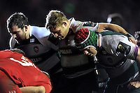 The Leicester Tigers front row of Fraser Balmain, Tom Youngs and Marcos Ayerza pack down for a scrum. European Rugby Champions Cup match, between Leicester Tigers and Munster Rugby on December 20, 2015 at Welford Road in Leicester, England. Photo by: Patrick Khachfe / JMP