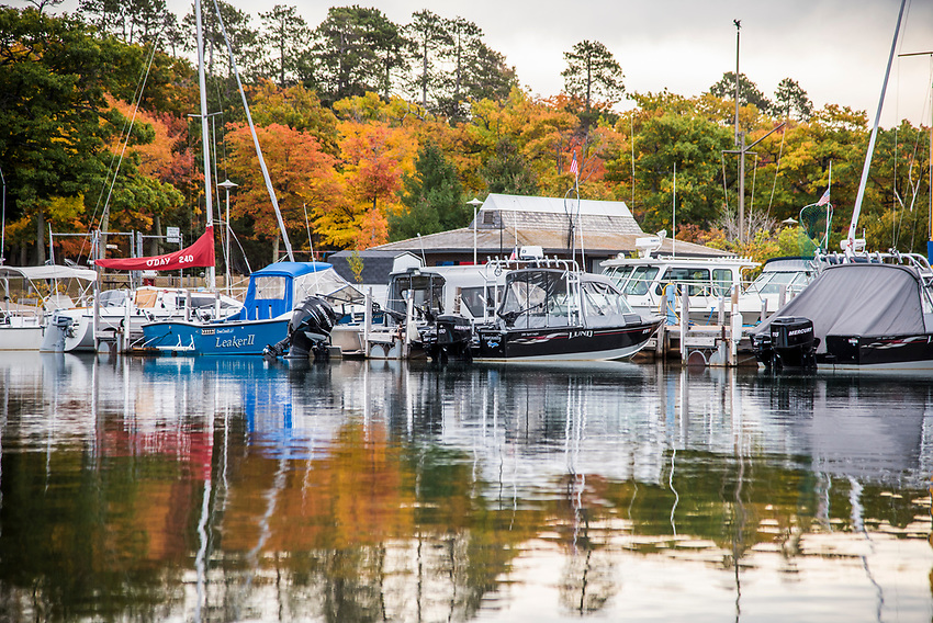 Fishing boats on Lake Superior with fall color at Presque Isle Marina, Marquette, Michigan.