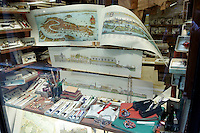 Antiche mappe in vetrina nella Legatoria La Fenice, a Venezia.<br /> Old maps in the window shop of the Legatoria La Fenice bindery in Venice.<br /> UPDATE IMAGES PRESS/Riccardo De Luca