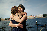 Yana Petrova embraces her girlfriend Elena Davydova (facing camera). On 30 June 2013, Russian President Vladimir Putin signed into law an ambiguous bill banning the 'propaganda of nontraditional sexual relations to minors'. The law met with widespread condemnation from human rights and LGBT groups. (MANDATORY CREDIT   photo: Mads Nissen/Panos Pictures /Felix Features)