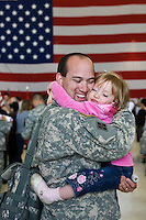 nationalguard  163958-- Staff Sgt. Brian Smith hugs his daughter Ashleigh Smith, (CQ) of Prescott Valley,  after members of the AZ National Guard 1404th Transportation Company and members of the 1/158 Infantry Battalion returned home from war Thursday. (Pat Shannahan/ The Arizona Republic)