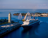 Cruise Ship with Fireboat Greeting, Aloha Tower Marketplace, Honolulu, Oahu, Hawaii, USA.