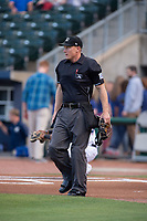 Home plate umpire Brian Walsh looks to the mound on May 13, 2019, at Arvest Ballpark in Springdale, Arkansas. (Jason Ivester/Four Seam Images)