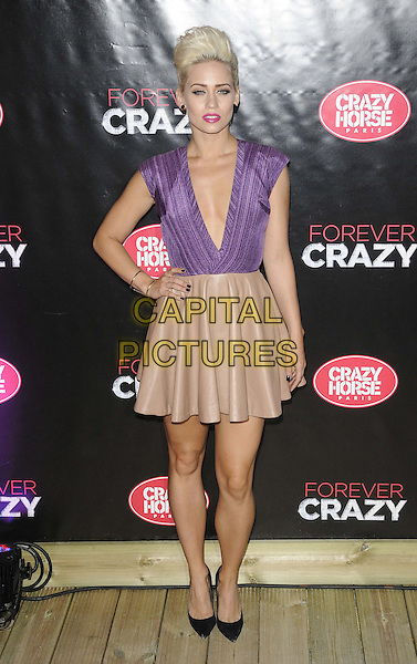 Kimberly Wyatt.Forever Crazy by Crazy Horse VIP Gala Night at South Bank, London, England..September 19th 2012.full length beige pink skirt black shoes purple sleeveless plunging neckline top hand on hip.CAP/CAN.©Can Nguyen/Capital Pictures.