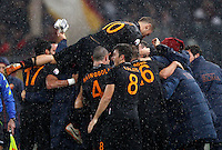 Calcio, semifinale di andata di Coppa Italia: Roma vs Napoli. Roma, stadio Olimpico, 5 febbraio 2014.<br /> AS Roma midfielder Kevin Strootman, of the Netherlands, is hidden by teammates' hugs after scoring during the Italian Cup first leg semifinal football match between AS Roma and Napoli at Rome's Olympic stadium, 5 February 2014.<br /> UPDATE IMAGES PRESS/Riccardo De Luca