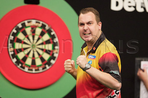 2.04.2015.  Manchester, England. Betway Premier League Darts. Judgement Night. Kim Huybrechts celebrates winning a leg.
